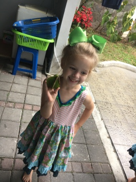 Kaybrietta posing with a star fruit that fell from our tree.