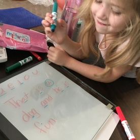 She was pretty excited about writing on the glass all by herself!