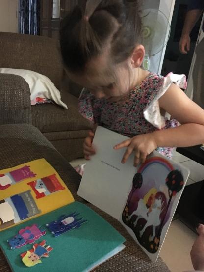 Lissie Joy reading 'Uni the Unicorn' to Goldilocks and the Three Bears.