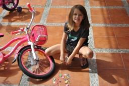 Working on her bike!